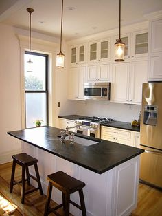 Oooh love the layout here. Good idea for a smaller kitchen. I would make the island a peninsula in my kitchen.  I like the glass fronted cupboards at the top of the overhead cupboards