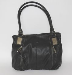 If it fits like a glove, then it must be this Tignanello black glove leather Hobo handbag. (www.handbagconsignmentshop.com)