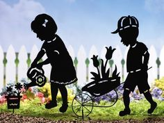 """Gardening Kids Outdoor Garden Shadow Stakes Boy By Collections Etc by Collections. $14.99. Adorable lawn silhouettes bring back cherished memories. Each has a black finish and stakes into the ground. 27""""H. Choose Boy or Girl."""
