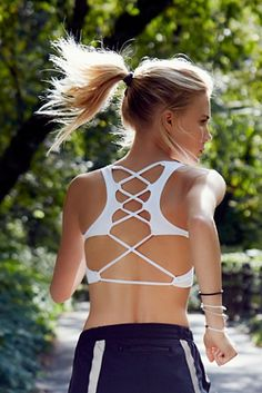 Lattice Back Bra | Free people Striking and sporty activewear essential soft bra with strappy lattice Picot Performance back.