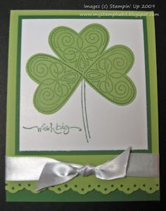 The gorgeous Stampin' Up full heart punch is used to create this shamrock. Dainty eyelet punch and jaunty white bow complete the look. DIY St Patrick's Card