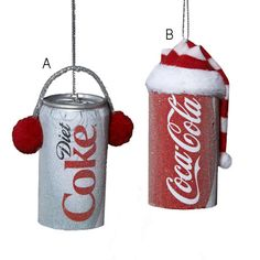 Christmas Coke. Coke and Diet Coke Christmas ornaments. Red ear muffs. Red and white hat.