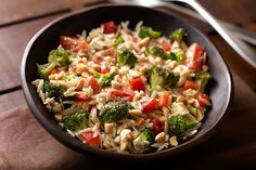 Italian dressing, feta and almonds give this orzo salad great flavor, but the festive color comes from broccoli and cherry tomatoes. Now it's perfect.