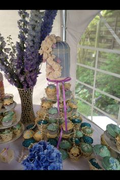 Handmade vintage birdcage and cupcakes for vintage christening