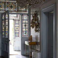 a different type of dramatic:  foyer with stained glass and metallic wallpaper