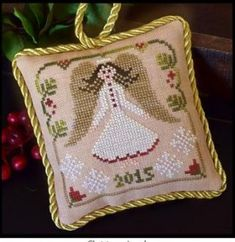 """""""Christmas Angel"""" is the title of this final design in the series and is stitched with Classic Colorworks"""