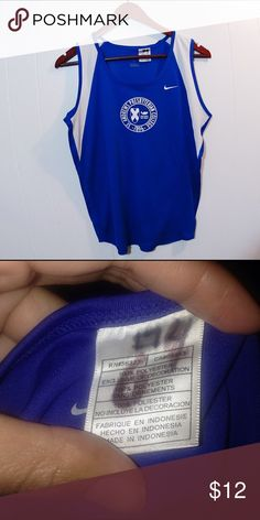 Nike Blue Athletic Tank Top Nike Athletic Tank Top. Has been used for cross country and has a number on the sticker (as shown in picture 2) but still in good conditions! Nike Tops Tank Tops
