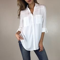 Classic White Blouse S M L Uber soft with a perfect classic fit. You can't go wrong with this chic blouse. Features pockets on the chest & roll up sle. White Shirts Women, Blouses For Women, White Blouses, Sheer White Blouse, Classic White Shirt, Boutique Tops, Types Of Sleeves, White Tops, Blouse Designs