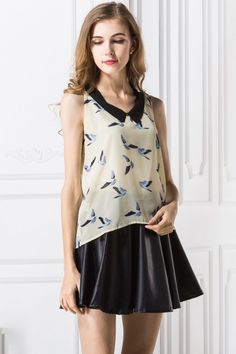 the top featuring brid pattern. peter pan collar. sleeveless. perfect with shorts or blue jeans.