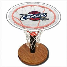 Cleveland Cavaliers NBA Basketball Sports Table by Spalding. $139.95. Wood grain base. Unique display for your treasured basketball.. Regulation size rim and authentic all-white net.. Assembled dimensions 24 inches H x 24 inches W x 24 Inches D.. 24 inch diameter clear acrylic top with your favorite NBA team logo. Bring home team pride to your living room with the Cleveland Cavaliers NBA Basketball Sports Table. This basketball hoop shaped coffee table features ...