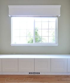 Window seat built from Ikea refrigerator cabinets. Complete with how to build around a floor vent #Baywindow
