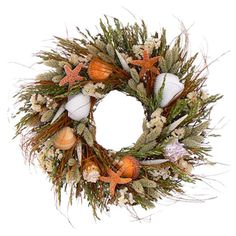 Assorted dried grass and seashell wreath.   Product: Wreath Construction Material:  Natural grass, sinuata, phalaris, a...