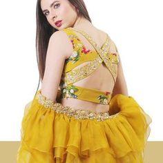 Mustard embellished harness back Lehenga set in our signature print.#details #detailshot . . . #mahimamahajan…