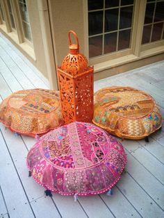 Floor pillows and lanterns by CRUSH