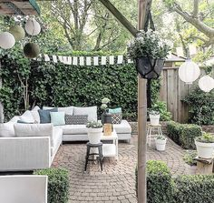 Backyard sectional seating area with circular paver patio. Ivy growing on fence and box hedge providing seclusion Outdoor Areas, Outdoor Rooms, Outdoor Living, Outdoor Decor, Landscape Design, Garden Design, Terrasse Design, Backyard Lighting, Brick Patios