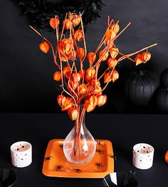 Orange Floral Centerpiece add in the grey cotton seed branches?  These r the rain tree pods