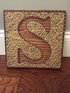 Custom Letter Art Inverse String Art Inverse by ShopAmbiguouS Handmade letter string art with gold nails and your choice of string color comes with sawtooth hanger. The wood is stained with Red Chestnut Minwax stain Board measures approximately Pin Art String, String Art Letters, Nail String Art, String Crafts, String Wall Art, Diy Letters, Monogram Wall Art, Diy Monogram, Letter Monogram