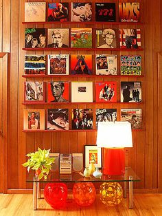 Record Album Display...I would love to do this in my house one day...and put vintage movie posters on the walls!