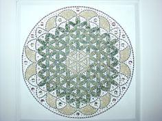 Mandala feita com Pedras Brasileiras, Cristais Swarovski e acrílcos. Tamanho total com moldura 75x75cm. www.mandalasdecristais.com.br