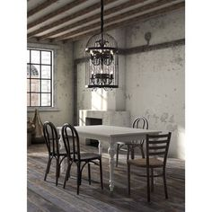 You'll love the unique style of this Canary ceiling lamp which resembles a bird cage holding a lovely chandelier full of crystals and flame bulbs. This rustic ceiling lamp is sure to provide antique appeal to your home.