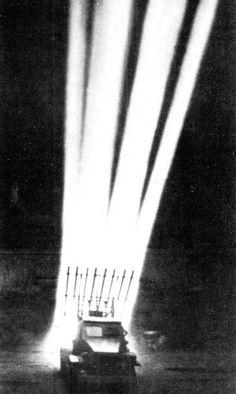 """Soviet """"Katyusha"""" multiple rocket launcher in action at night, 1941 – 1945."""