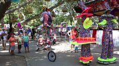 Video about Clowns on stilts and unicycle in Cismigiu park, Bucharest, Romania. Video of harlequin, adult, makeup - 77397371