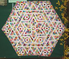 "1801 1/4"" sided hexagons in this miniature quilt."