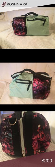 """Lululemon Travel Bag Sea foam green and floral design, travel bag. Great for long weekend getaways. Bag has been gently used but in excellent condition. There are multiple compartments, including a laptop zippered pocket on the bottom of the bag. Comes with shoulder strap and mesh nylon shoe bag. 18""""L, 12""""H, 10""""W. lululemon athletica Bags Travel Bags"""