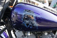 Harley tank. Owner did the paint job, I did the faces on both sides.