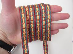 Ravelry: lnrskye's X's and O's Tablet woven band