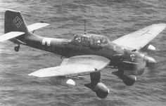 German dive bomber Junkers Ju-87 (Ju.87R) from the 4th Squadron 2 Squadron dive bombardirovschikovm (4.StG2) flying at low level flight over the Mediterranean Sea.