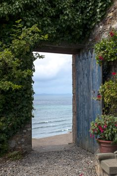 An entryway to the beach can look however it likes, but flowers and vines just make the path that much more alluring.