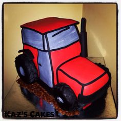 Tractor Cake. This is a chocolate cake with white chocolate ganache and decorated in fondant. #cake #cakedecorating #tractor #fondant