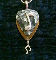 Silver Gold Metallic Eighth Note guitar pick necklace $26 - Contact us thru website