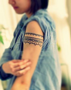 Lace tattoo around the arm