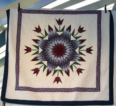 This quilt is Spring Star; the pattern is from Judy Martin's 1987 book, Shining Star Quilts. This example was Amish made.