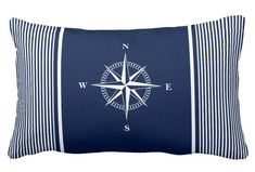 Blue Striped Pillow with Nautical Star. Beautiful decor pillow for nautical living room and bedroom. For everyone who loves nautical, New England, Hamptons and Nantucket Interior Style. #nautical #pillow #star