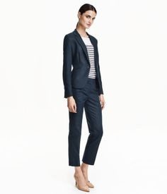Low-rise suit pants in herringbone-patterned, linen-blend fabric. Hook-and-eye fastener, side pockets, and one welt back pocket.