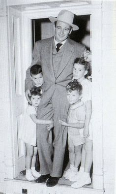 "John Wayne  Family - ""Children in a family are like flowers in a bouquet: there's always one determined to face in an opposite direction from the way the arranger desires."" ~   Marcelene Cox"