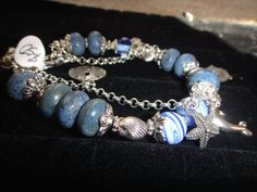 Sealife Coral bracelet. made with blue Coral beads, glass beads, and pewter sea life charms pewter rope toggle clasp. bracelet size 8