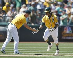Oakland Athletics' Khris Davis, right, is congratulated by third base coach Chip Hale (4) after hitting a two-run home run against the Washington Nationals during the seventh inning of a baseball game on Sunday, June 4, 2017, in Oakland, Calif. (AP Photo/Tony Avelar) Photo: Tony Avelar, Associated Press