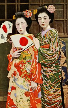 "Maiko Fumi and Friend (1940)    ""Maiko Fumi on the right-hand side in the green kimono, with another unidentified Maiko (Apprentice Geisha) in orange. Early 30's - 40's"