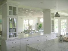 Open kitchen I like the idea of using cabinets to disguise supports.