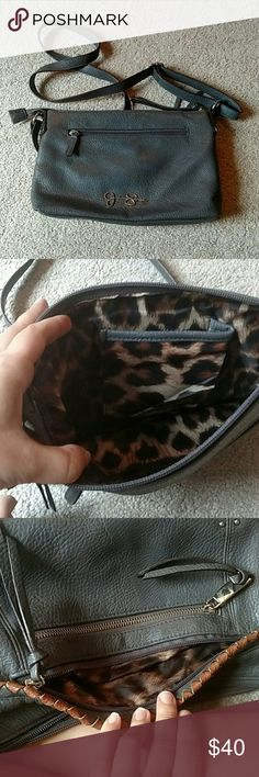 Jessica Simpson Purse Navy Blue, crossbody, inside is lepord print, three zipper pockets on the outside, in very good condition to have been used. Jessica Simpson Bags Crossbody Bags