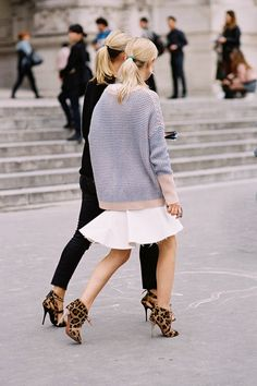 proportions. Long sweater over short skirt and leopard shoes