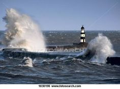 Waves crashing by lighthouse, Seaham, Teesside, England