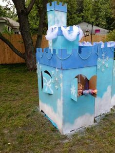 Frozen castle..made out of two big boxes, couple cans of spray paint and some xmas decorations and still loads of fun.