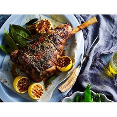 Spanish-style barbecue leg of lamb recipe - By Australian Women's Weekly, This deliciously tender piece of lamb is cooked using traditional Spanish flavours, combining salty chorizo and fragrant garlic and thyme to create a memorable dish for a roast dinner or Christmas lunch.