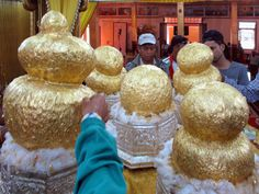 Only men can apply gold leaf to the five ancient Buddha images at Phaung Daw Oo Pagoda southwest of Inle Lake, Myanmar (Burma). So much gold has been added over the years that the Buddhas have lost their shapes. Inle Lake, Gold Leaf, Buddha, Lost, Shapes, Men