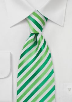Puccini has created a stunning bright green and white striped tie that is perfect for any spring or summer ensemble. This tie looks best with suits in navy, tan , and gray. Our favorite look for this beautiful green & white tie: navy suit, white dress shirt, and chocolate brown shoes with matching brown belt.